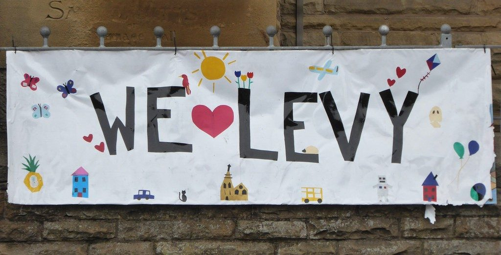 Banner saying 'we love Levenshulme'