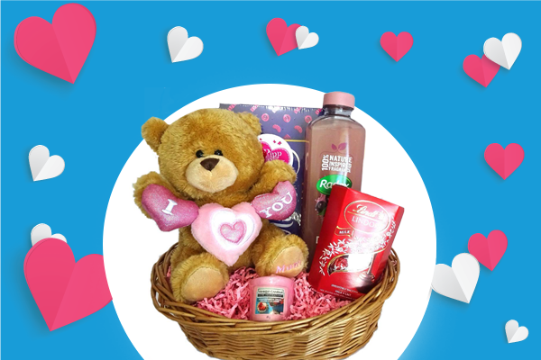 A graphic for the mothers day competition. A hamper with multiple prizes including bubble bath, a teddy, chocolates and a candle.