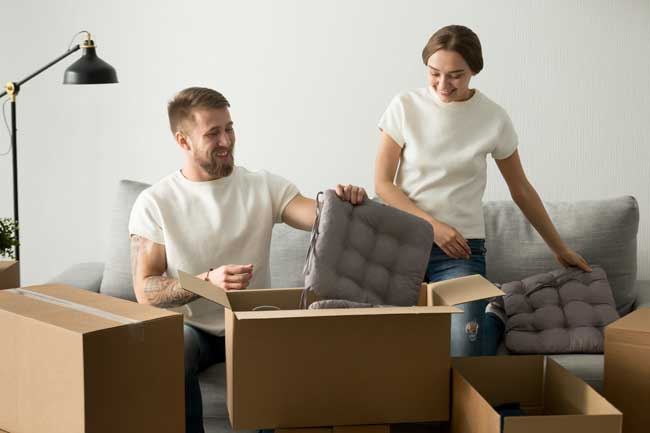 couple packing away to move home