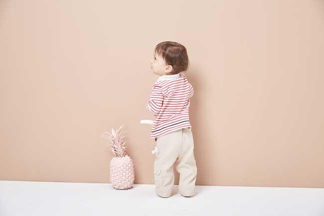 toddler next to pinapple